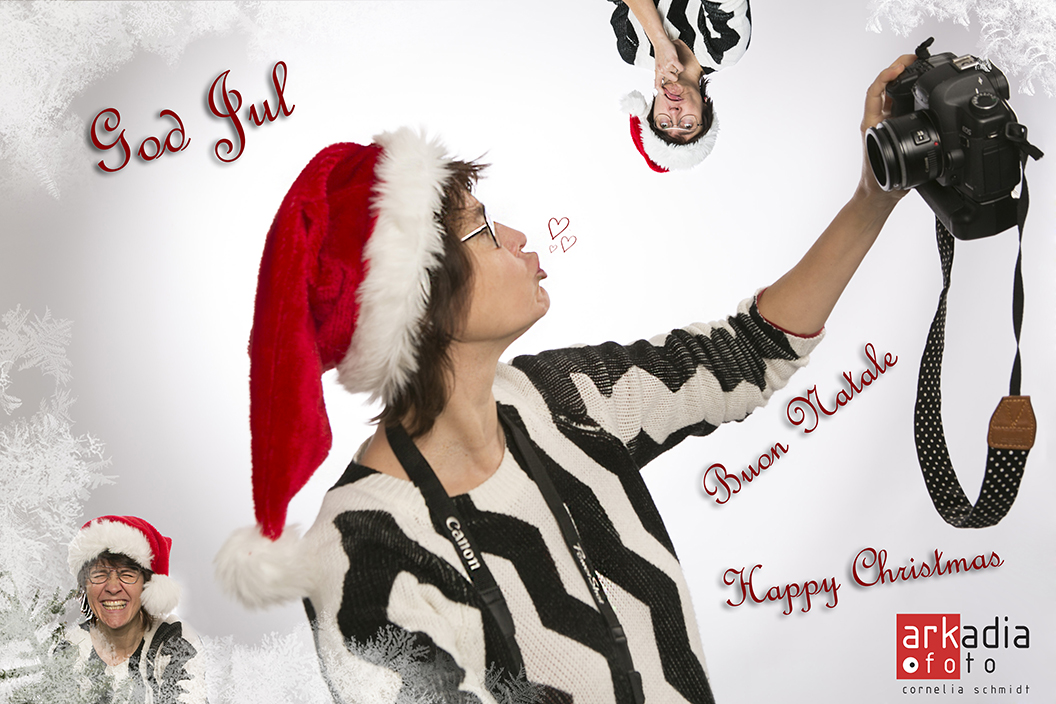 Cornelia Schmidt holding a camera and wishing a Happy Christmas