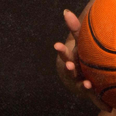 Hand and a basketball