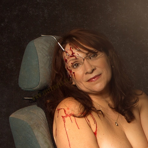 Woman sitting in a crushed car